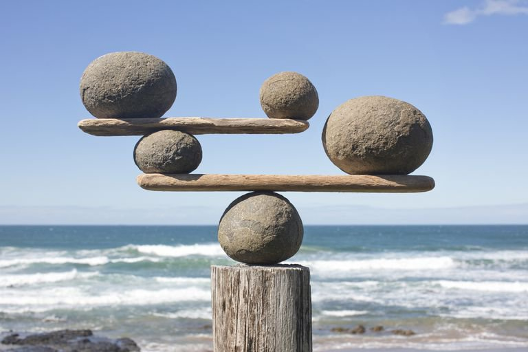 rocks-balancing-on-driftwood--sea-in-background-153081592-591bbc3f5f9b58f4c0b7bb16.jpg